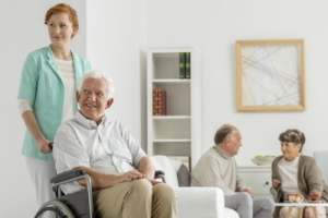 senior in a wheelchair and caregiver